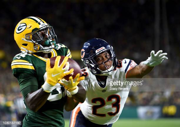 Geronimo Allison of the Green Bay Packers catches a touchdown against Kyle Fuller of the Chicago Bears during the fourth quarter of a game at Lambeau...