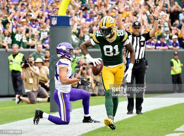 Geronimo Allison of the Green Bay Packers celebrates after scoring a touchdown in the first quarter against the Minnesota Vikings at Lambeau Field on...
