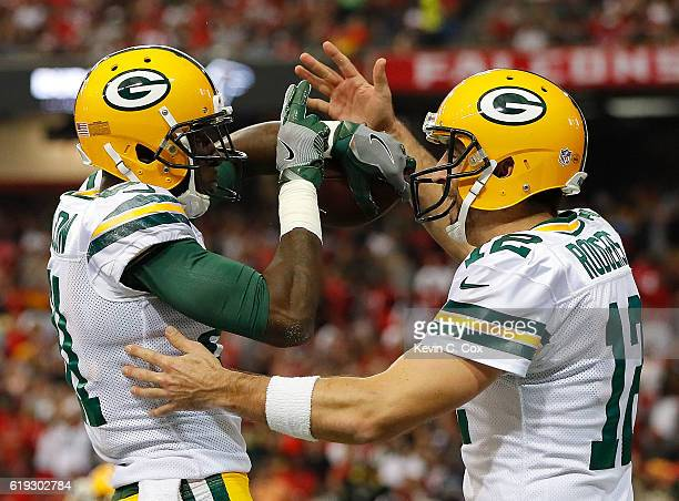 Geronimo Allison of the Green Bay Packers celebrates his touchdown reception from Aaron Rodgers against the Atlanta Falcons at Georgia Dome on...