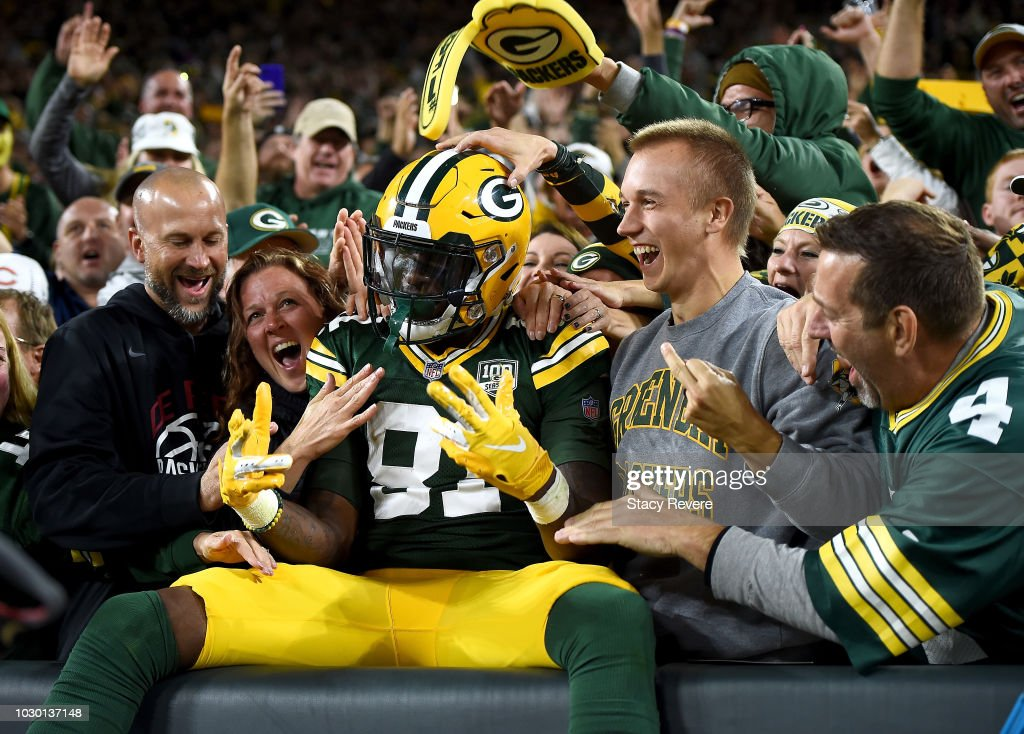 Geronimo Allison #81 of the Green Bay Packers celebrates with a 'Lambeau Leap' after scoring a touchdown during the fourth quarter of a game against the Chicago Bears at Lambeau Field on September 9, 2018 in Green Bay, Wisconsin.