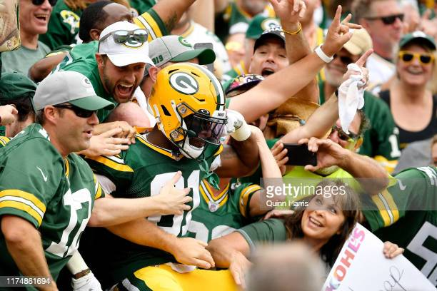 Geronimo Allison of the Green Bay Packers celebrates with fans after scoring a touchdown in the first quarter against the Minnesota Vikings at...