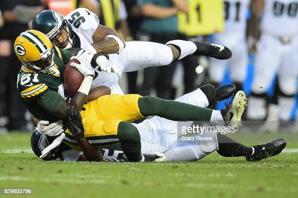 Geronimo Allison of the Green Bay Packers is brought down by Mychal Kendricks of the Philadelphia Eagles during the second quarter of a preseason...