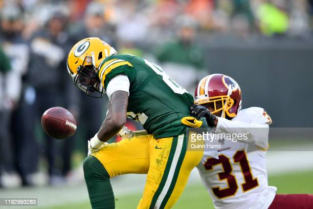 Geronimo Allison of the Green Bay Packers looses the football in the second half against Fabian Moreau of the Washington Redskins at Lambeau Field on...