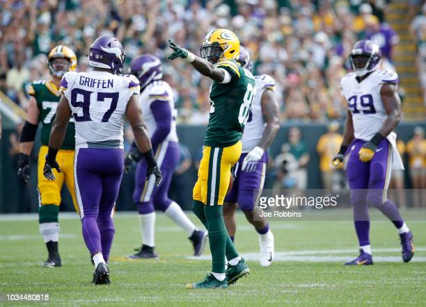 Geronimo Allison of the Green Bay Packers reacts after catching a pass for a first down in the fourth quarter of a game against the Minnesota Vikings...