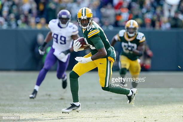 Geronimo Allison of the Green Bay Packers runs with the ball in the second quarter against the Minnesota Vikings at Lambeau Field on December 24 2016...