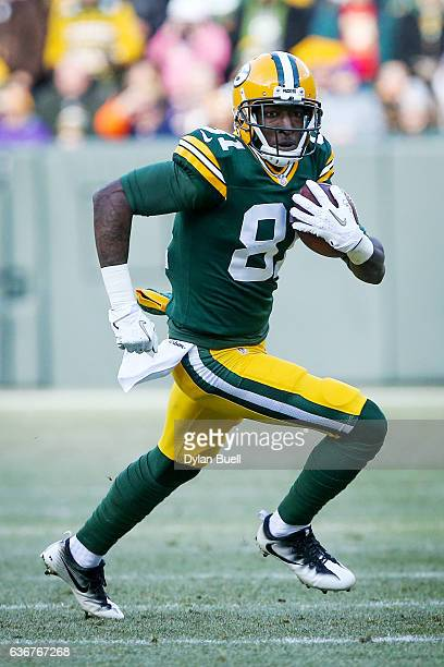 Geronimo Allison of the Green Bay Packers runs with the ball in the first quarter against the Minnesota Vikings at Lambeau Field on December 24 2016...
