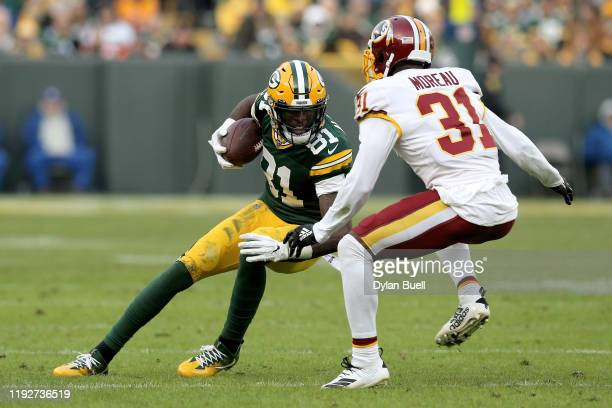Geronimo Allison of the Green Bay Packers runs with the ball while being chased by Fabian Moreau of the Washington Redskins in the fourth quarter at...