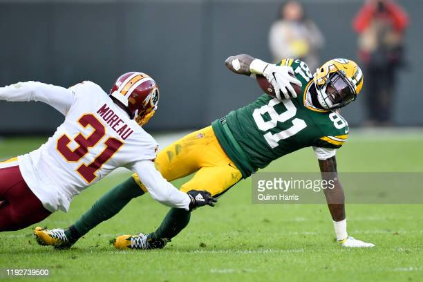Geronimo Allison of the Green Bay Packers slides to get the first down against Fabian Moreau of the Washington Redskins at Lambeau Field on December...