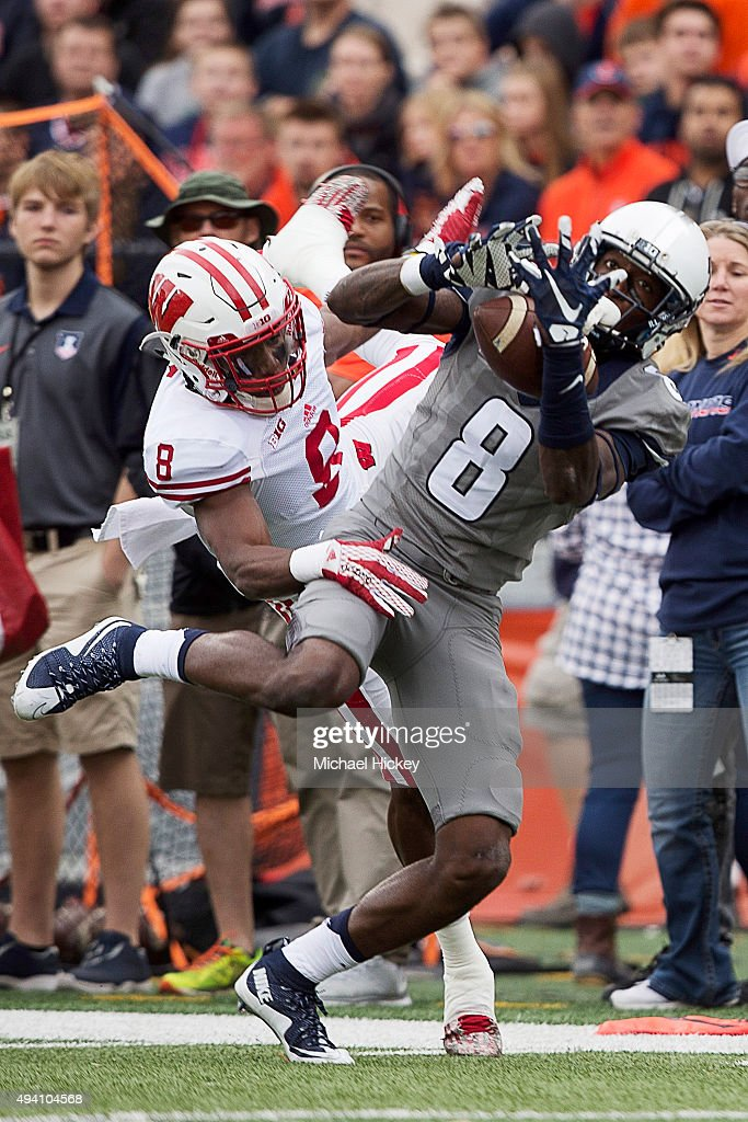 Geronimo Allison #8 of the Illinois Fighting Illini makes a catch as Sojourn Shelton #8 of the Wisconsin Badgers defends at Memorial Stadium on October 24, 2015 in Champaign, Illinois.