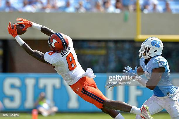 Geronimo Allison of the Illinois Fighting Illini makes as leaping catch as MJ Stewart of the North Carolina Tar Heels defends during their game at...