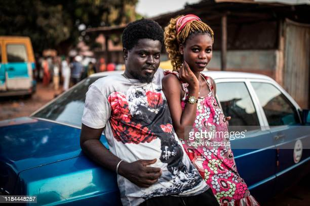 Geronimo and Joana a young couple stand outside a polling station after they voted in the popular Bairro Militar area of the capital Bissau in...