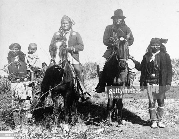 Geronimo atop the horse at left poses with members of his Chiricahua Apache tribe After the Chiricahua Reservation was abolished he led several raids...