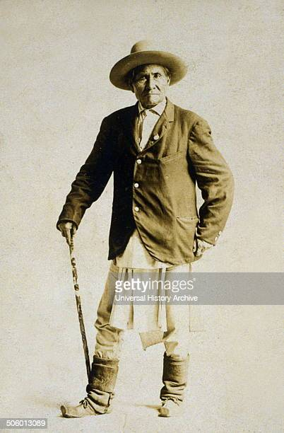 Geronimo fulllength portrait standing facing front with walking stick Photo by