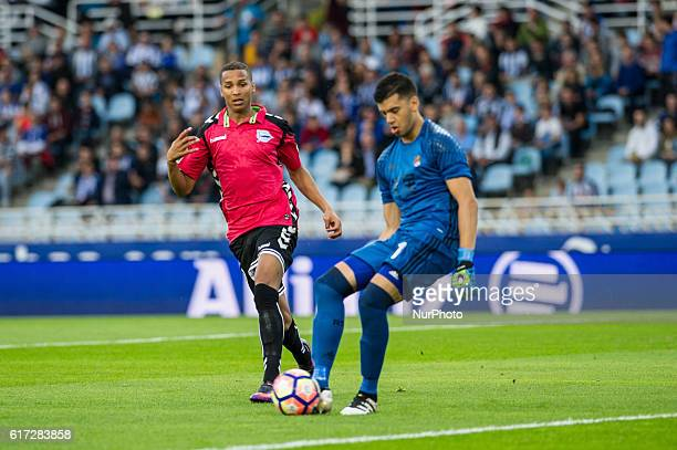 Geronimo Rulli of Real Sociedad duels for the ball with Deyverson of Alaves during the Spanish league football match between Real Sociedad and Betis...