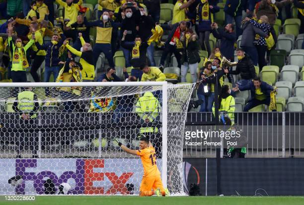 Geronimo Rulli of Villarreal celebrates with fans following their team's victory in the penalty shoot out during the UEFA Europa League Final between...
