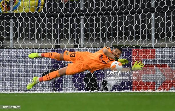 Geronimo Rulli of Villarreal saves the eleventh penalty from David De Gea of Manchester United in the penalty shoot out during the UEFA Europa League...