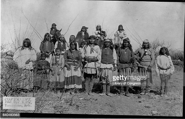 Geronimo the Apache Chief that lead resistance to US policy to consolidate his people on reservations stands with other Apache warriors women and...