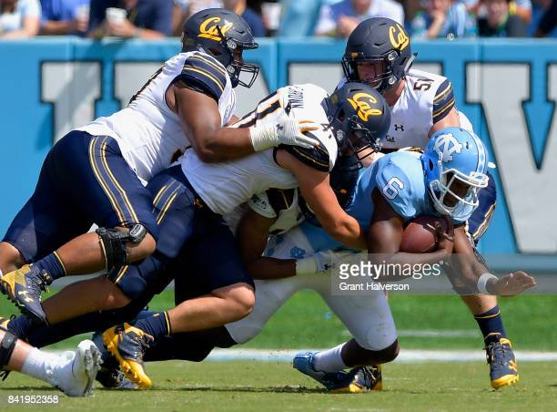 Gerran Brown and Cameron Saffle of the California Golden Bears sack Brandon Harris of the North Carolina Tar Heels during their game at Kenan Stadium...