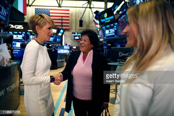 Gerri Willis shakes hands with Nancy Lopez at the New York Stock Exchange for the Augusta National Women's Amateur press tour on March 27 2019 in New...