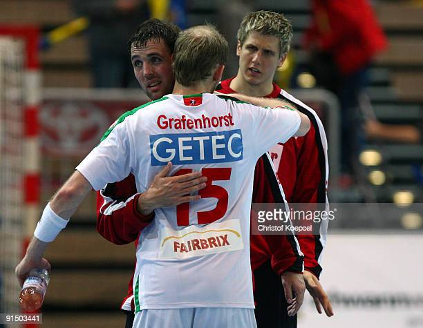 Gerrie Eijlers and Yves Grafenhorst of Magdeburg celebrate the 2921 victory after the Toyota Handball Bundesliga match between HSG Duesseldorf and SC...