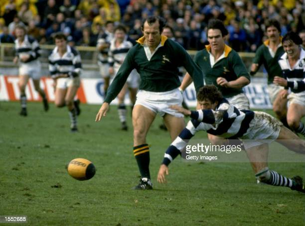 Gerrie Germishuys of South Africa kicks the ball ahead during a match against Auckland at Eden Park New Zealand Mandatory Credit Allsport UK /Allsport