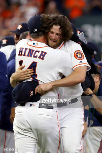 Gerrit Cole and AJ Hinch of the Houston Astros embrace after their teams 61 win over the Tampa Bay Rays in game five of the American League Division...