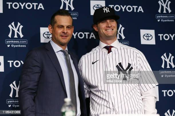 Gerrit Cole and Manager, Aaron Boone of the New York Yankees pose for a photo at Yankee Stadium during a press conference at Yankee Stadium on...