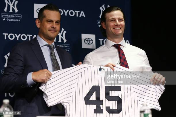 Gerrit Cole and Manager Aaron Boone of the New York Yankees pose for a photo at Yankee Stadium during a press conference at Yankee Stadium on...