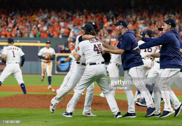 Gerrit Cole of the Houston Astros congratulates Roberto Osuna after defeating the Tampa Bay Rays in game five of the American League Divisional...