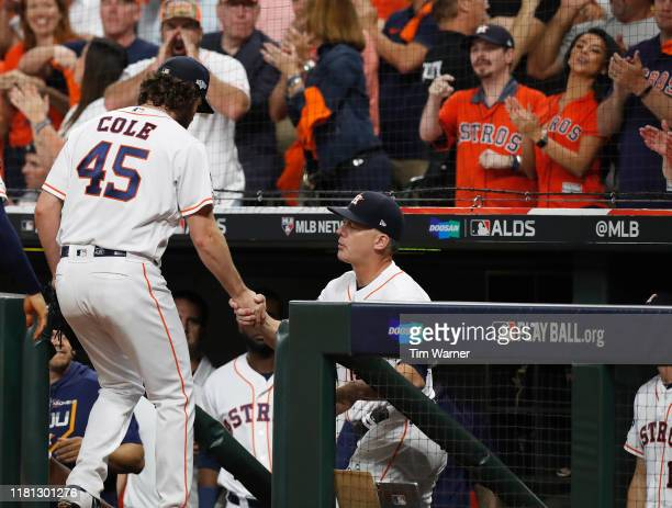 Gerrit Cole of the Houston Astros is greeted by manager manager AJ Hinch after pitching in the eighth inning against the Tampa Bay Rays during game...