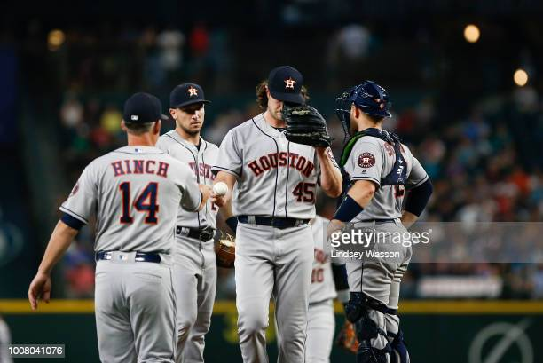 Gerrit Cole of the Houston Astros is taken out of the game against the Seattle Mariners in the seventh inning by Astros manager AJ Hinch at Safeco...