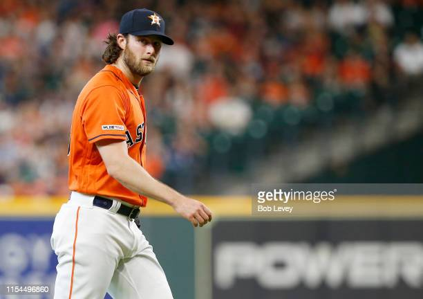 Gerrit Cole of the Houston Astros looks toward home plate as he walks off the mound in the first inning against the Baltimore Orioles at Minute Maid...