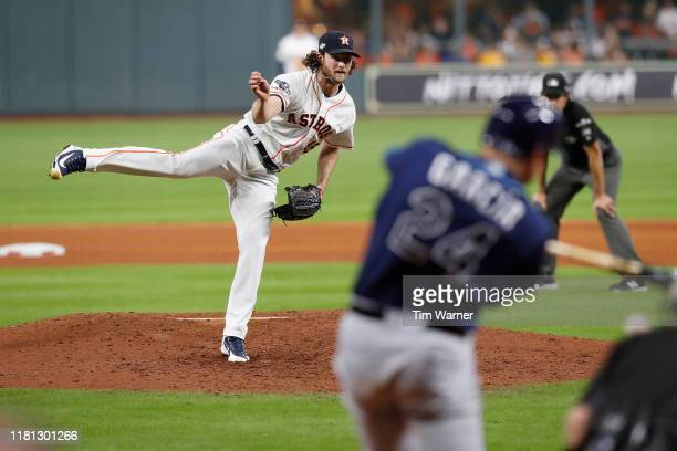Gerrit Cole of the Houston Astros pitches to Avisail Garcia of the Tampa Bay Rays in the seventh inning during game five of the American League...