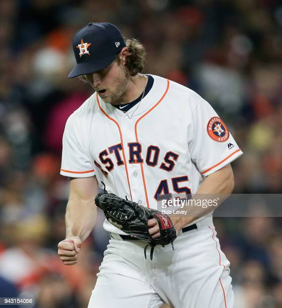 Gerrit Cole of the Houston Astros pumps his fist after striking out Hunter Renfroe of the San Diego Padres in the fourth inning at Minute Maid Park...