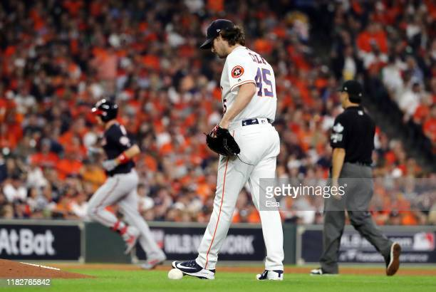 Gerrit Cole of the Houston Astros reacts after allowing a solo home run to Ryan Zimmerman of the Washington Nationals during the second inning in...