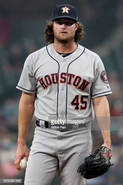 Gerrit Cole of the Houston Astros reacts after walking Kyle Seager of the Seattle Mariners in the first inning at Safeco Field on August 20 2018 in...