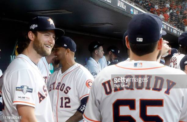 Gerrit Cole of the Houston Astros talks with Jose Urquidy before game one of the American League Division Series against the Tampa Bay Rays at Minute...
