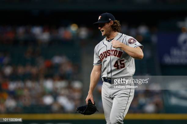 Gerrit Cole of the Houston Astros walks off the field after losing a perfect game attempt by walking Nelson Cruz of the Seattle Mariners in the fifth...