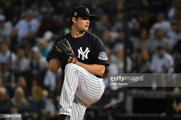 Gerrit Cole of the New York Yankees delivers a pitch in the first inning during the spring training game against the Pittsburgh Pirates at...