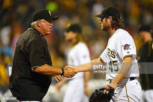 Gerrit Cole of the Pittsburgh Pirates celebrates his complete game with manager Clint Hurdle during interleague play against the Seattle Mariners on...