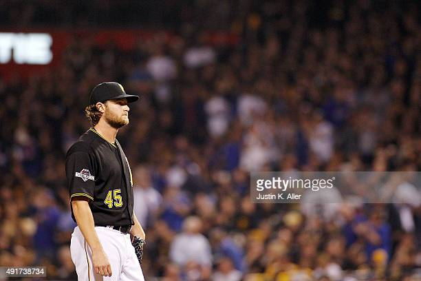 Gerrit Cole of the Pittsburgh Pirates reacts after giving up a two-run home run to Kyle Schwarber of the Chicago Cubs in the third inning during the...