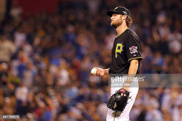 Gerrit Cole of the Pittsburgh Pirates reacts after giving up a tworun home run in the third inning during the National League Wild Card game against...