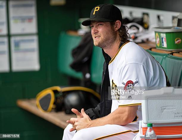 Gerrit Cole of the Pittsburgh Pirates sits in the dugout in the second inning during the game against the Houston Astros at PNC Park on August 24...
