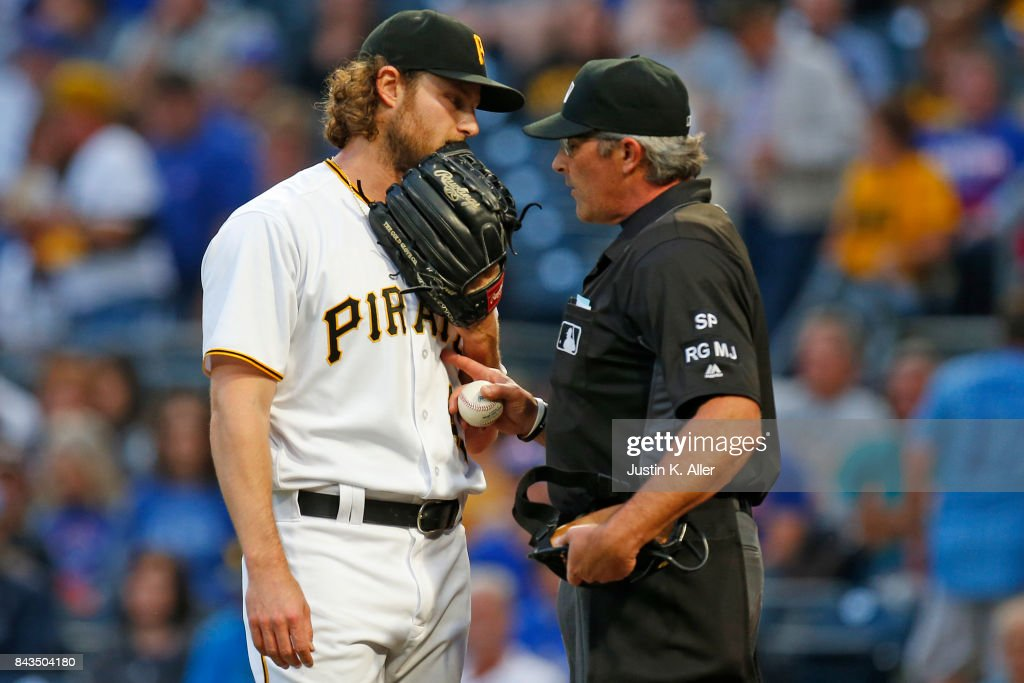 Gerrit Cole #45 of the Pittsburgh Pirates talks with home plate umpire Paul Nauert between innings against the Chicago Cubs at PNC Park on September 6, 2017 in Pittsburgh, Pennsylvania.