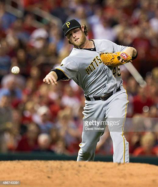 Gerrit Cole of the Pittsburgh Pirates throws to first for the out in the fourth inning of a game against the St Louis Cardinals at Busch Stadium on...