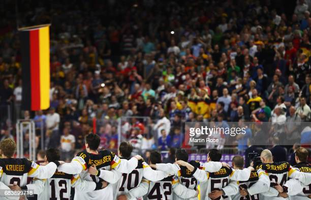 Gerrit Fauser of Germany celebrates victory with his team mates after the Germany v Latvia match of the 2017 IIHF Ice Hockey World Championships at...