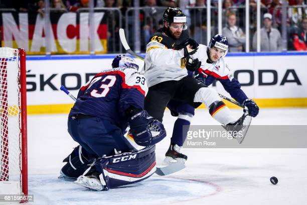Gerrit Fauser of Germany tries to score agains Julius Hudacek goalkeeper of Slovakia during the 2017 IIHF Ice Hockey World Championship game between...