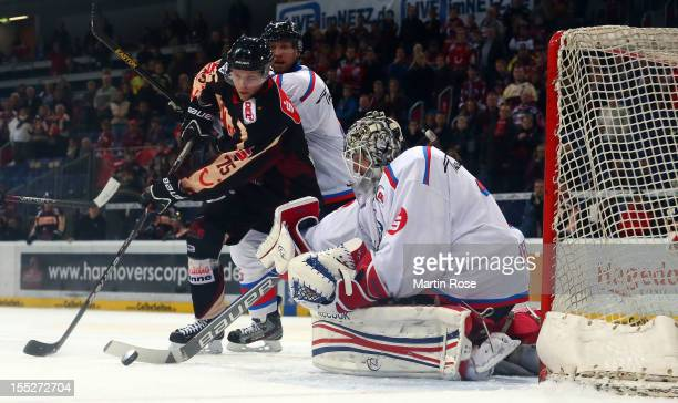 Gerrit Fauser of Hannover fails to score over Tyler Wyman goaltender of Nuernberg during the DEL match between Hannover Scorpions and Thomas Sabo Ice...