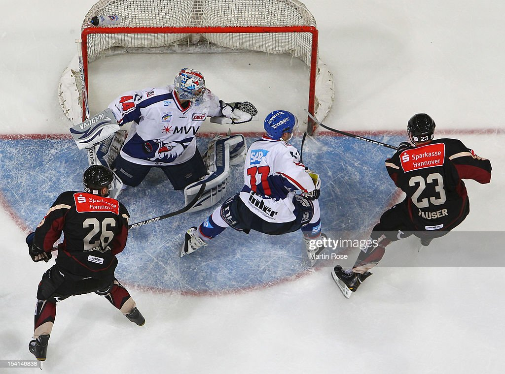 Gerrit Fuaser (#23) of Hannover faisl to score over Dennis Endras (C), goaltender of Mannheim during the DEL match between Hannover Scorpions and Aadler Mannheim at TUI Arena on October 14, 2012 in Hanover, Germany.