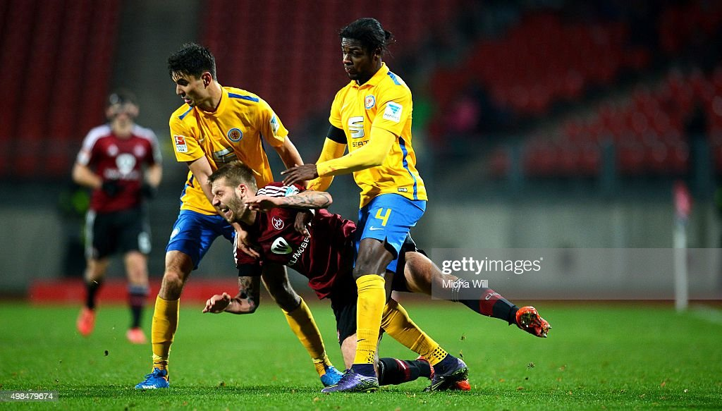 Gerrit Holtmann of Braunschweig, Guido Burgstaller of Nuernberg and Joseph Baffo of Braunschweig tussle for the ball during the Second Bundesliga match between 1. FC Nuernberg and Eintracht Braunschweig at Grundig-Stadion on November 23, 2015 in Nuremberg, Germany.